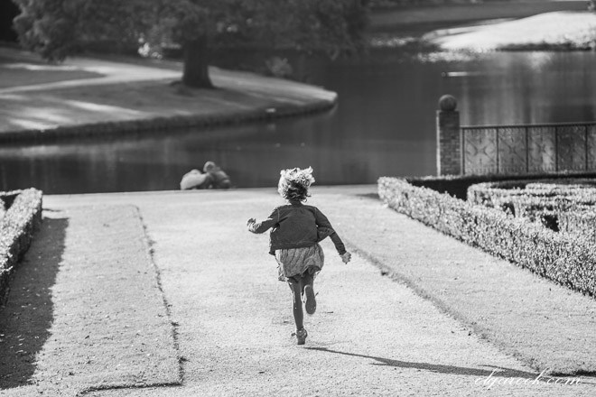 nostalgic photo of a little girl running through a park