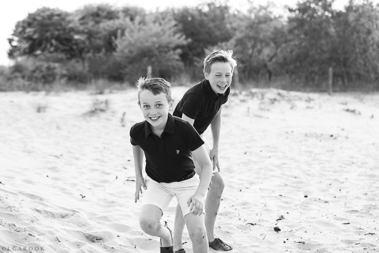 brothers play and laugh in the dunes