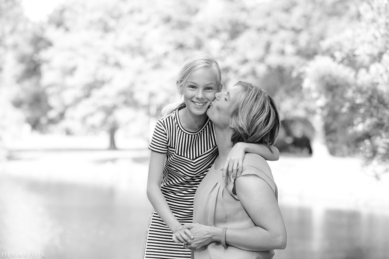 happy mother and daughter in a sunny park
